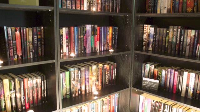 bookshelf candlelight